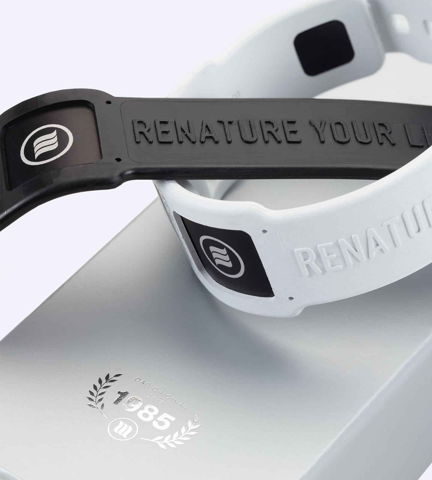 memonizerBODY sport in schwarz und weiß auf der silbernen Transportverpackung mit Logo seit 1985